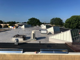 Thumbnail photo of the Library roof depicting six new roof monitors.